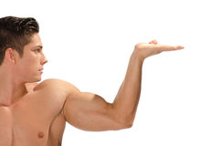 Muscular man showing your product Stock Photos