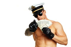 Muscular man shows money Stock Photo