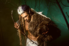 Muscular man with skin and dreadlocks among the trees Royalty Free Stock Images