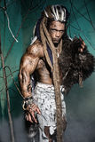 Muscular man with skin and dreadlocks among the trees Royalty Free Stock Photography