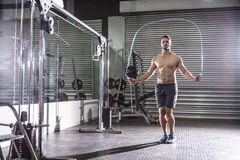 Muscular man skipping. In crossfit gym Royalty Free Stock Photos