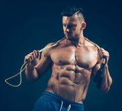 Muscular man skipping rope. Portrait of muscular Royalty Free Stock Photography
