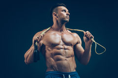 Muscular man skipping rope. Portrait of muscular Royalty Free Stock Images