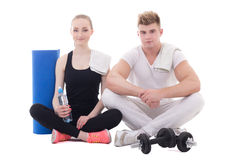 Muscular man and slim woman relaxing after training isolated on Royalty Free Stock Photos