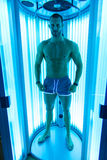 Muscular Man At Solarium In Beauty Salon Stock Photo