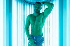 Muscular Man At Solarium In Beauty Salon Royalty Free Stock Photo