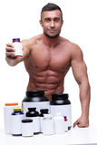 Muscular man with sports nutrtion Royalty Free Stock Images
