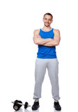 Muscular man standing with arms folded Stock Photos