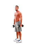 Muscular man standing with dumbbells Royalty Free Stock Images
