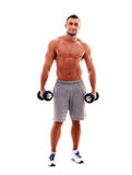 Muscular man standing with dumbbells Royalty Free Stock Photos