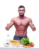muscular man standing with thumbs up Royalty Free Stock Image