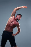 Muscular man stretching Royalty Free Stock Photos