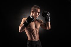 Muscular man in studio on dark background Stock Image