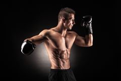 Muscular man in studio on dark background Stock Photo