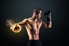 Muscular man in studio on dark background Royalty Free Stock Photo