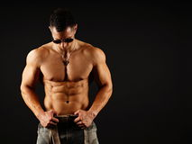Muscular man in sunglasses poses Stock Photography
