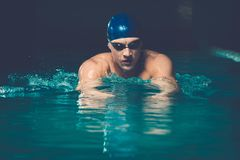 Muscular man in swimming pool Stock Images