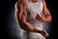 A muscular man with a syringe royalty free stock photos