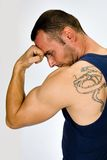Muscular man with tattoo Stock Photo