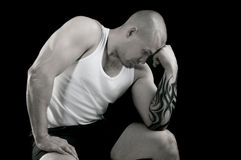 Muscular man with tattoo. Muscular man with a tattoo on his arm Royalty Free Stock Images