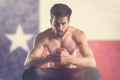 Muscular man with Texas Flag behind. Muscular man stock photos