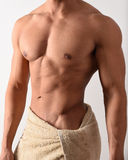 Muscular man in a towel Stock Photo