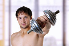 Muscular man training Royalty Free Stock Images