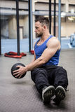 Muscular man training with exercise ball stock image