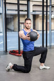 Muscular man training with medicine ball royalty free stock photo