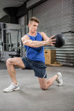 Muscular man training with medicine ball royalty free stock photos