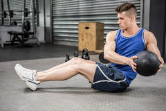 Muscular man training with medicine ball. At the crossfit gym stock images