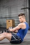 Muscular man training with medicine ball stock photography