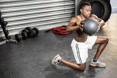 Muscular man training with medicine ball royalty free stock image