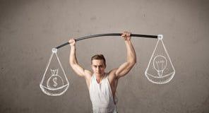 Muscular man trying to get balanced Royalty Free Stock Photos