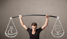 Muscular man trying to get balanced Stock Photography