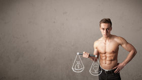 Muscular man trying to get balanced Royalty Free Stock Images