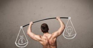 Muscular man trying to get balanced Royalty Free Stock Image