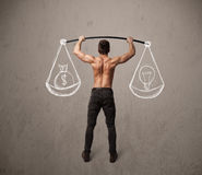 Muscular man trying to get balanced Royalty Free Stock Photography