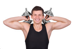 Muscular  man with two dumbbells Stock Image