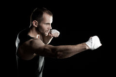 Muscular man, tying an elastic bandage on his hand Royalty Free Stock Photo