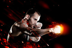 Muscular man, tying an elastic bandage on his hand Stock Photography