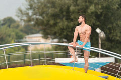 Muscular Man In Underwear Resting At Swimming Pool Royalty Free Stock Photos