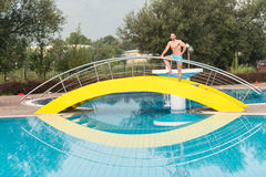 Muscular Man In Underwear Resting At Swimming Pool Royalty Free Stock Photography