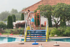 Muscular Man In Underwear Resting At Swimming Pool Royalty Free Stock Images