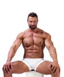 Muscular man in underwear  on white. Background Royalty Free Stock Photography