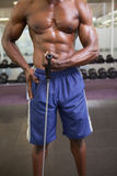 Muscular man using resistance band in gym Royalty Free Stock Photos