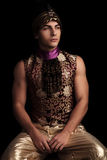 Muscular man in venetian costume pose looking away Royalty Free Stock Photography