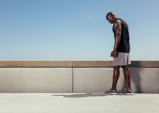 Muscular man on walkway getting ready for his run Royalty Free Stock Photography