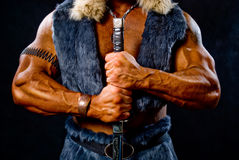 Muscular man warrior with a sword Stock Photo