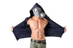Muscular man wearing antigas mask, naked ripped torso Royalty Free Stock Images